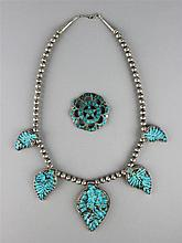 W. PAQUIN NECKLACE TOGETHER WITH A STAR BROOCH