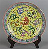 CHINESE FAMILLE ROSE NINE DRAGON DISH, FOUR-CHARACTER QIANLONG MARK IN OVERGLAZE BLUE