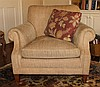 PAIR OF BEIGE UPHOLSTERED CLUB CHAIRS, FROM THE DENISE AND JEFF AUSTIN HOME