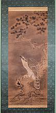 SHUSEN (JAPANESE, 19TH CENTURY) HAWK ON A PINE TREE Ink on paper mounted on silk hanging scroll: 35 x 14 1/2 in.