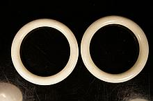 Two Chinese antique white jade bangles