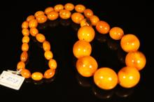 Chinese antique Egg Yolk Amber beads necklace; 87.5 grams