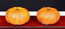 PAIR OF SHOU-SHAN STONE ORANGES