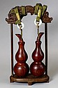 PAIR OF HUANGHUALI GOURD PENDANTS  Condition: Good