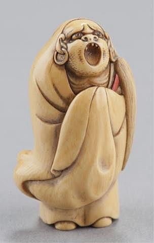 An ivory netsuke of Daruma.