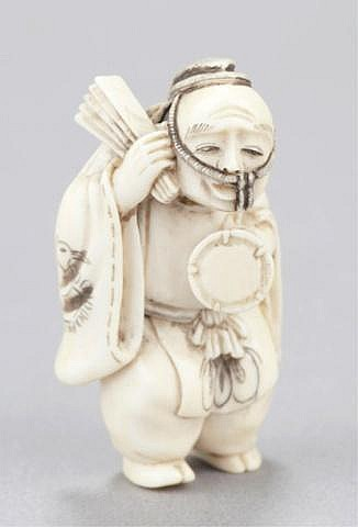 An ivory netsuke of a dancer.