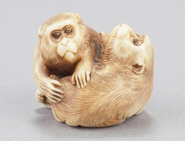 An ivory netsuke of two monkeys.