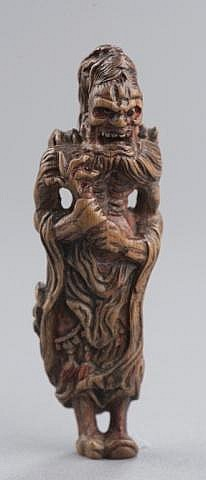 An early wood netsuke of Ryujin.