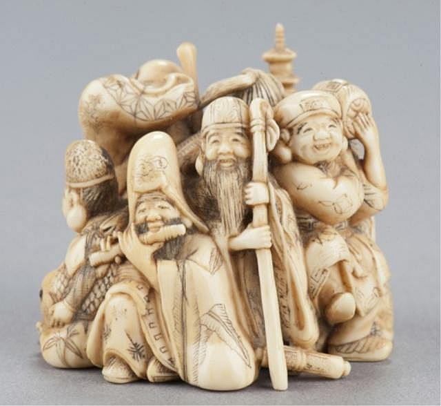 An ivory netsuke of the Seven Happy Gods.