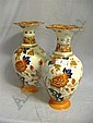 Pair of late Victorian Wedgwood oviform vases with flared necks and printed Imari palette, floral decoration, impressed marks to base, 30 cm