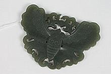 Chinese carved green jade pendant in the form of a