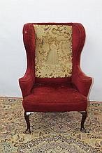 Georgian-style wing back armchair with red upholst