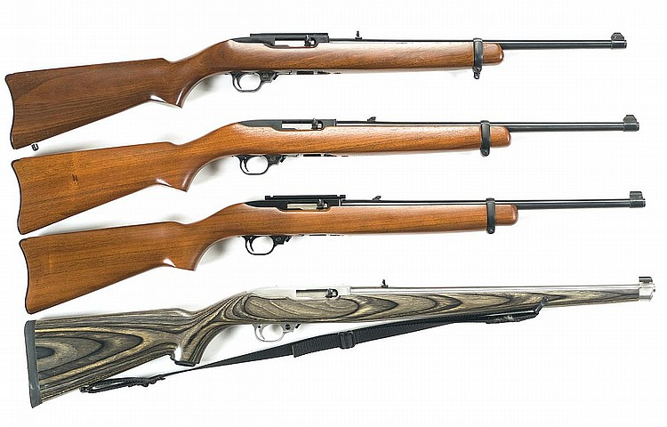 Four Ruger Model 10/22 Carbines -A) Ruger Model 10/22 Standard Semi-Automatic CarbineB) Ruger Model 10/22 Standard Semi-Automatic CarbineC) Ruger Model 10/22 Standard Semi-Automatic CarbineD) Stainless Ruger Model 10/22 Laminated Stock International