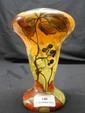 LEGRAS Vase balustre. épreuve de tirage industriel réalisée en verre marmoréen orange et jaune. Décor de vigne vierge, émaillé. Signé. Haut. 13 cm.