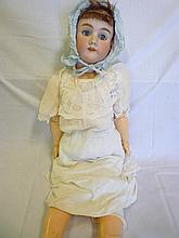 A good quality old porcelain headed doll by Simon