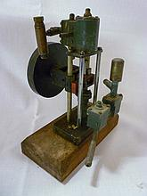 A small steam vertical pump with flywheel on