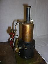 A steam powered single cylinder vertical engine