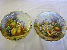 A pair of French GDA Limoges china circular plaque