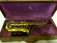 A brass saxophone by Hawkes & Son model