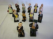 A set of twelve old Royal Doulton china figures -