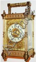 France, eight day time, strike and hour repeating carriage clock, lever platform, white enamel Arabic numeral dial, blued steel hands, gilt dial mask and center with acanthus leaf engraving, polished pillars style case with turned feet and finials,