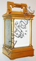 France, eight day petit sonnerie striking carriage clock with lever platform, gilt Anglaise case with beveled glass panels, white enamel Roman numeral dial, blued steel hands, c1880