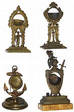 Watch Holders- 4 (Four) military themed cast metal : one with marble base; standing Napoleon; anchor; standing armored figure; all antique