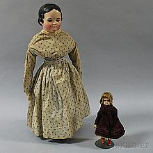 Two Dolls, a small wax-over-composition shoulder head doll with inset blue glass eyes and composition body, (cracking to face), ht. 8,