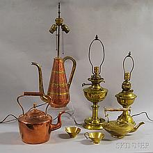 Seven Copper and Brass Items, a copper tea kettle, a brass tea kettle with turned wood swing-handle, three lamps: a copper and brass co
