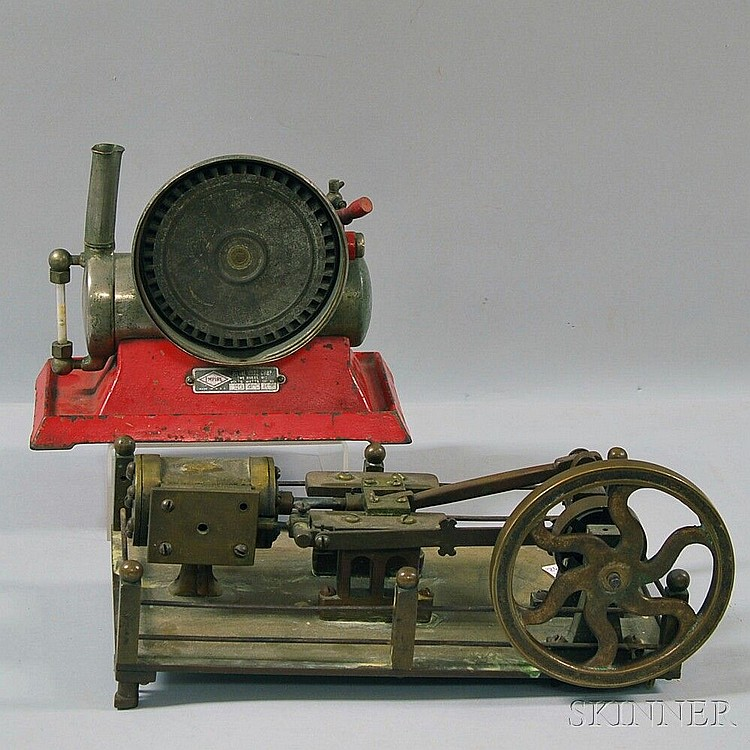 Two Steam Models, a brass bench-made steam engine with a 5-in. flywheel and a 2-in. stroke, and a Empire steam boiler model with a red