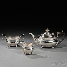 Three-piece George V Sterling Silver Tea Service, London, 1927-28, C.S. Harris & Sons, maker, each monogrammed with squat bodies on bal