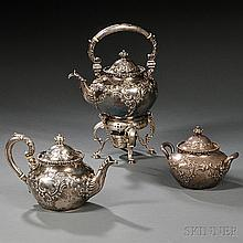 Dominick & Haff Three-piece Partial Tea Service, New York, c. 1895, each squat bulbous form decorated throughout with flowers and rocai