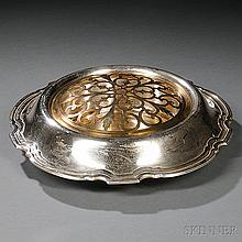 Tiffany & Co. Sterling Silver Center Bowl, New York, 1907-47, with a gilt-brass inset frog and overhanging rim with various names and d