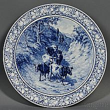 Royal Bonn Delft Blue and White Charger, Germany, late 19th century, wide fruit border surrounding a central landscape with cows after