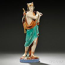 Royal Worcester Majolica Figure of a Hunter, England, c. 1875, the standing figure supporting a dead rabbit and pheasant upon his back,