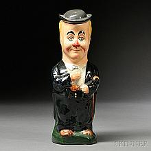 Royal Doulton George Robey Toby Jug and Cover, England, c. 1925, polychrome enamel decorated, after a design by Charles Noke, printed m