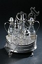 ASSEMBLED GEORGE III SILVER CRUET SET, Date marks for 1788, 1799, 1814. - 9 1/2 in. high, stand.