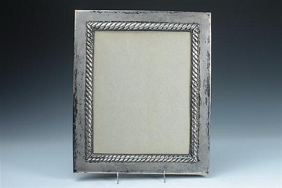 PERUVIAN STERLING SILVER FRAME, Mid-20th century. - 16 3/4 in. x 14 in., overall; 13 in. x 10 1/2 in. picture size.