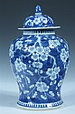 CHINESE BLUE AND WHITE PORCELAIN BALUSTER JAR AND COVER, Kangxi four character underglaze blue mark, 19th century. - 14 in. high.