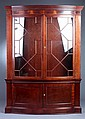 GEORGIAN STYLE MAHOGANY BOW-FRONT CHINA CABINET, 21st century. - 88 in. x 62 in. x 19 in.