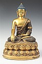TIBETO-CHINESE GILT BRONZE FIGURE OF BUDDHA, - 10 1/2 in. high.