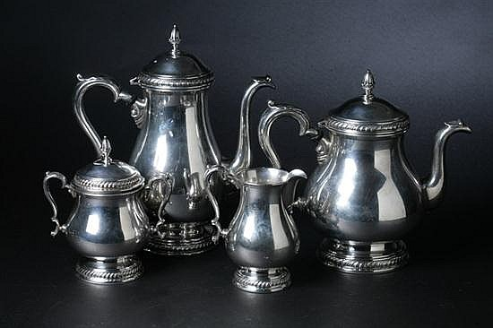 FOUR-PIECE INTERNATIONAL STERLING SILVER TEA AND COFFEE SET. - 62 oz., 8 dwt.; 10 3/4 in. high, coffee pot.