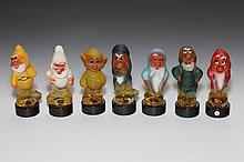 SOVIET RUSSIAN PAINTED GLASS SCENT BOTTLES OF THE SEVEN DWARVES, With Cyrillic paper label, inscribed CCCP and with name of each dwarf.
