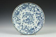 CHINESE BLUE AND WHITE PORCELAIN DRAGON SHALLOW BOWL, Xuande six-character underglazed blue mark. - 10 7/8 in. diam.