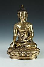 CHINESE GILT BRONZE FIGURE OF BUDDHA. - 13 in. high.