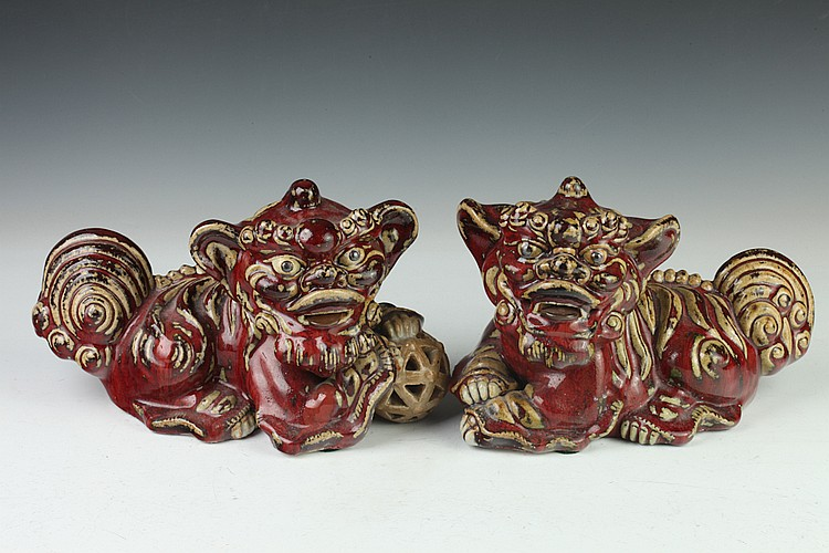 PAIR JAPANESE COPPER RED PORCELAIN FIGURES OF SHI SHI, - 11 1/2 in. long.