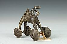 INDIAN BRONZE CAMEL ON WHEELS, - 4 1/2 in. high.