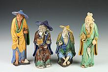 FOUR CHINESE MUD FIGURES OF MEN, - Largest: 11 1/2 in. high.