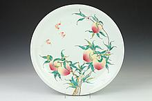 CHINESE FAMILLE ROSE PORCELAIN PEACH CHARGER, Yongzheng mark. - 17 3/4 in. diam.