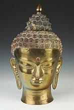 NEPALESE BRONZE HEAD OF BUDDHA. - 18 1/2 in. high.